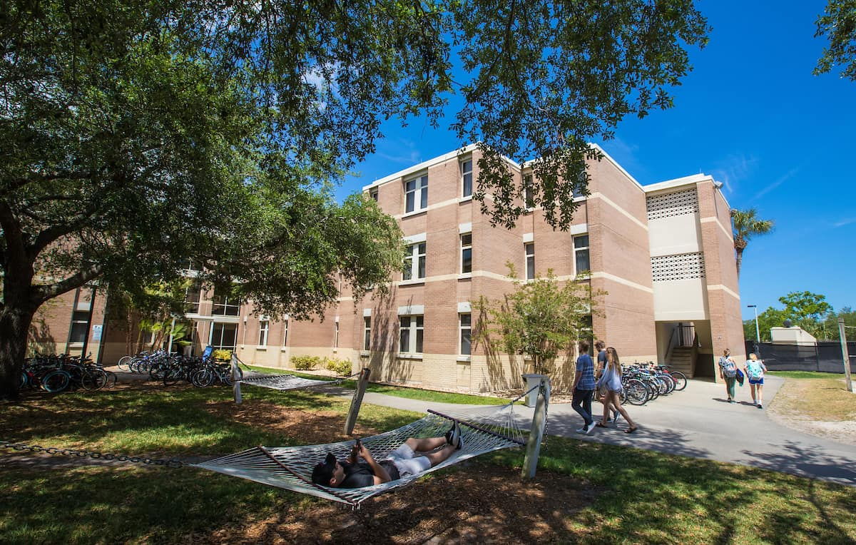 students outside a residence hall