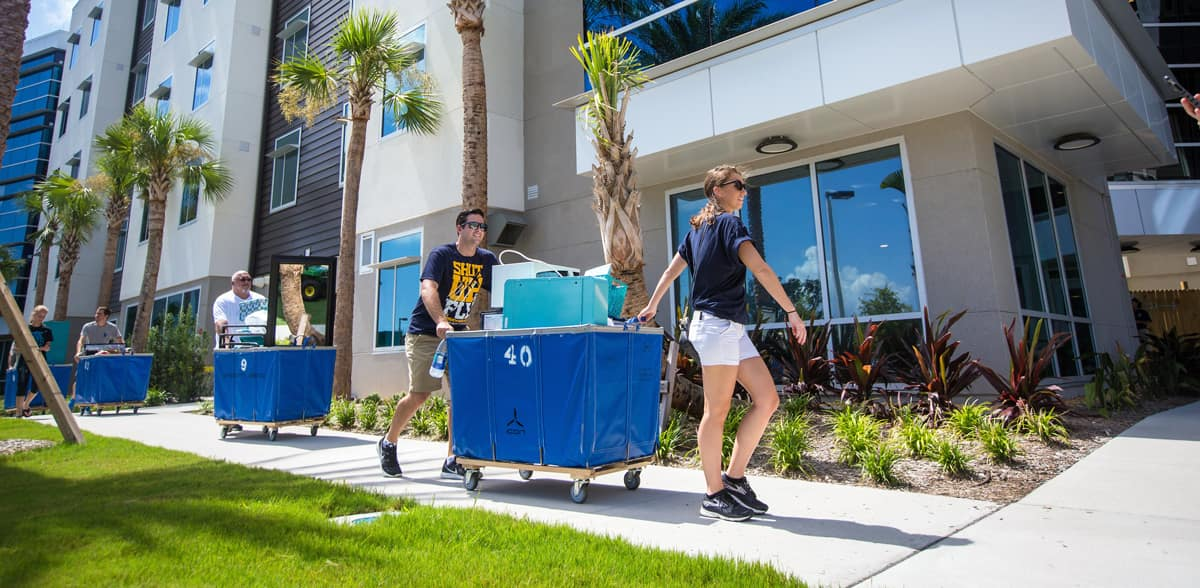 Student move into the new residence hall.