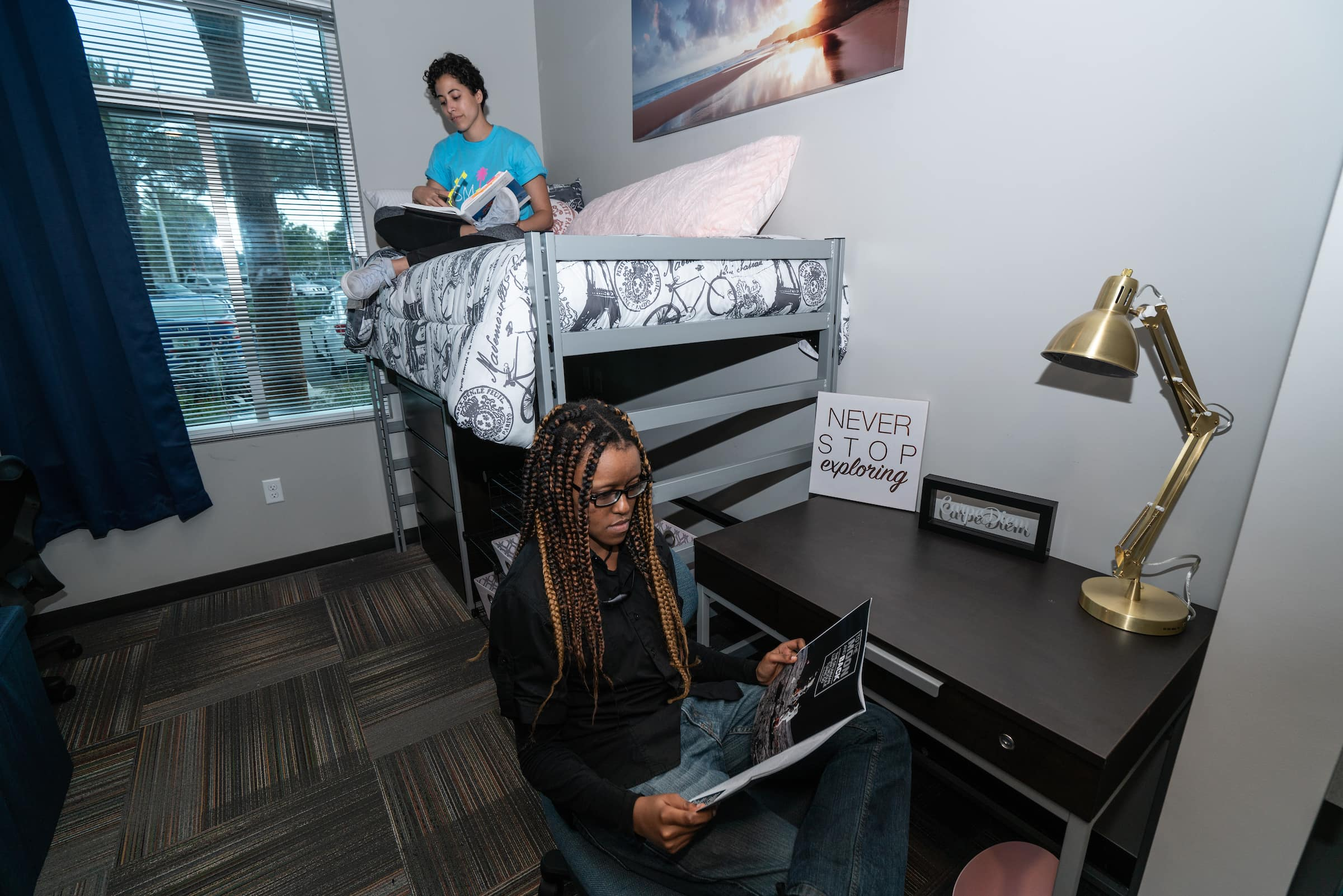 Two students hang out in a New Hall Room.