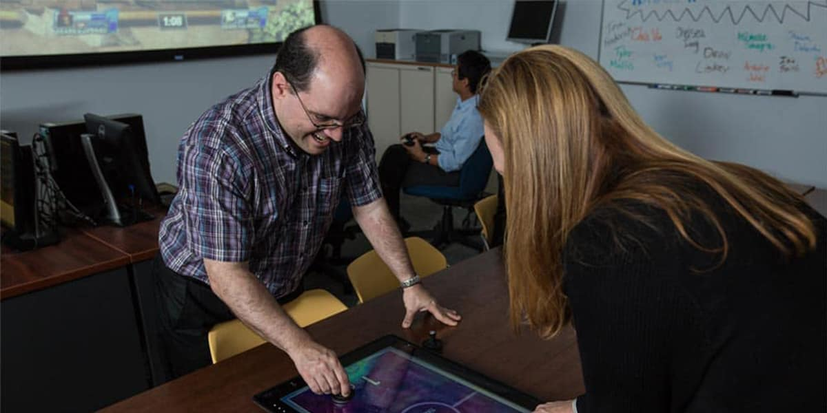 Human factors faculty and students play video games in the GEARS Lab.