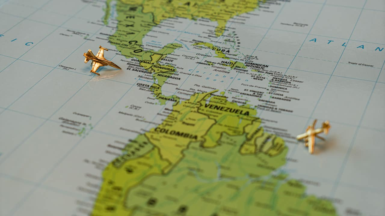Map of Western Hemisphere with model planes on it.