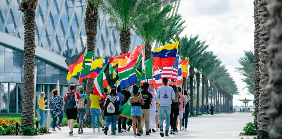 International students performing a flag parade