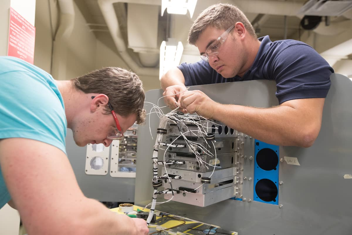Students work on aircraft electronics in the Avionics Lab