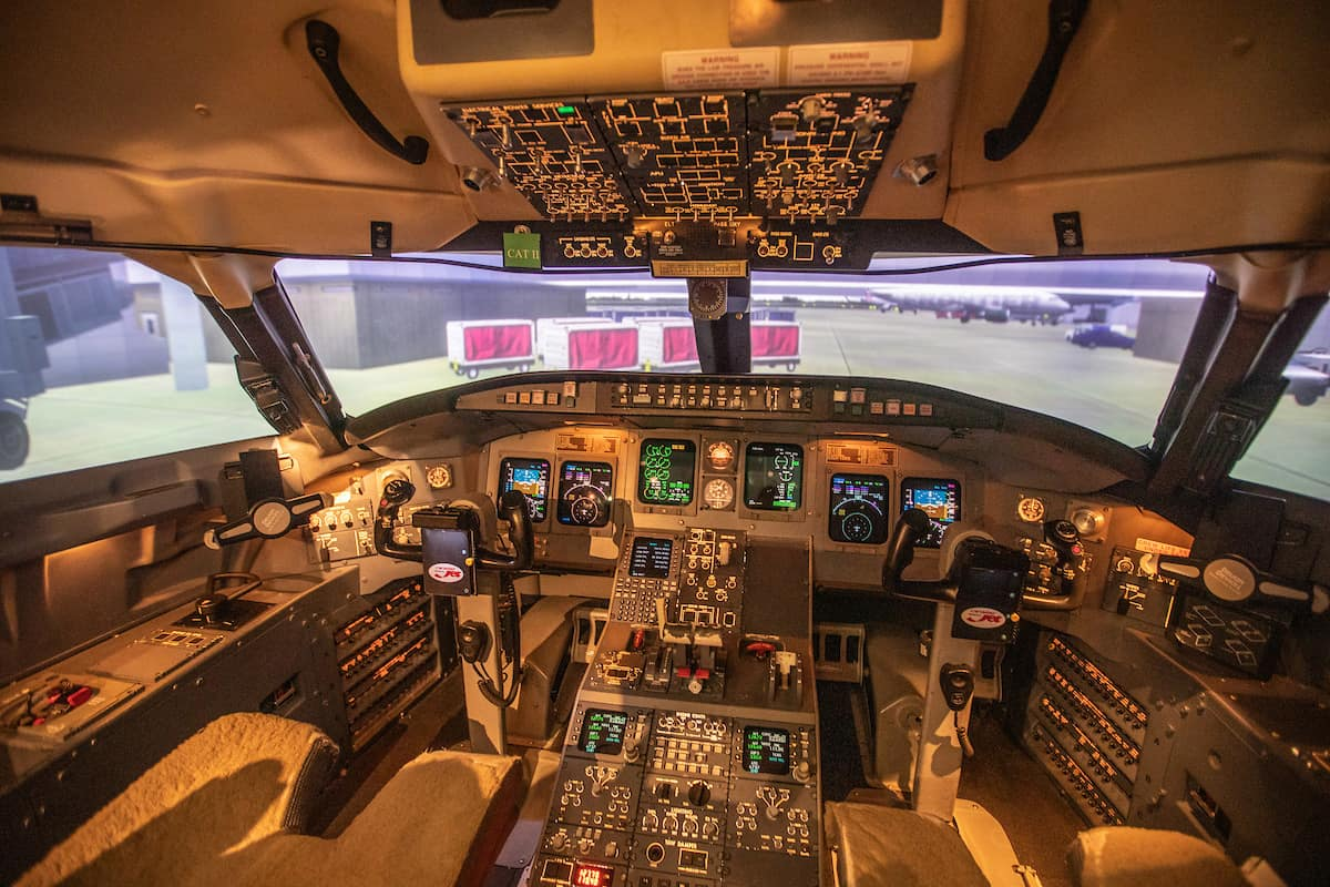 Students train in a flight simulator