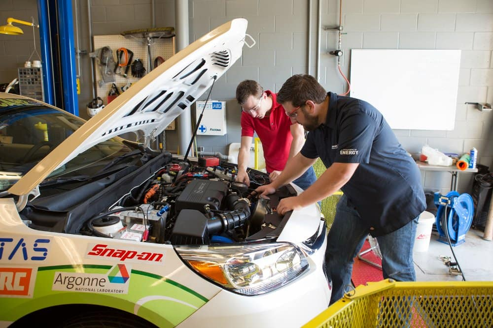 Students work on the EcoCar in the Advanced Vehicles Green Garage