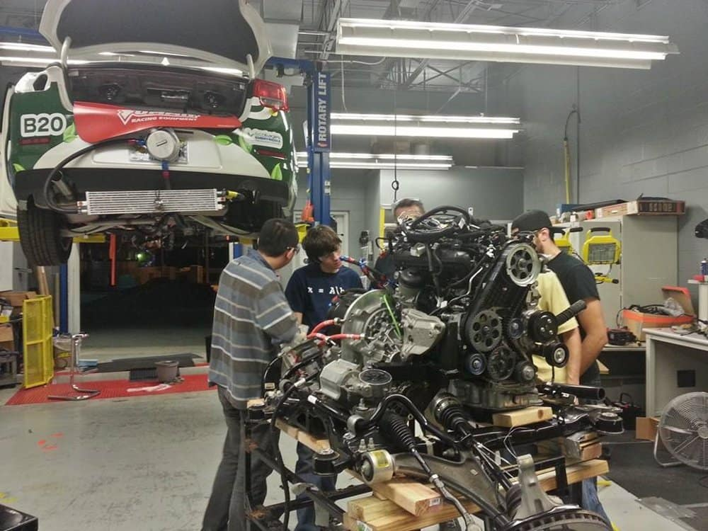 Students work on the EcoCar engine
