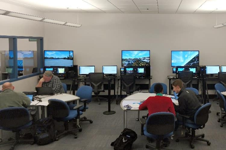 Students work in groups at the Aviation Learning Center.
