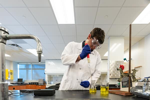 Chemistry student performs experiments in chemistry lab