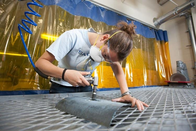 A student works on a project in the Composites Lab