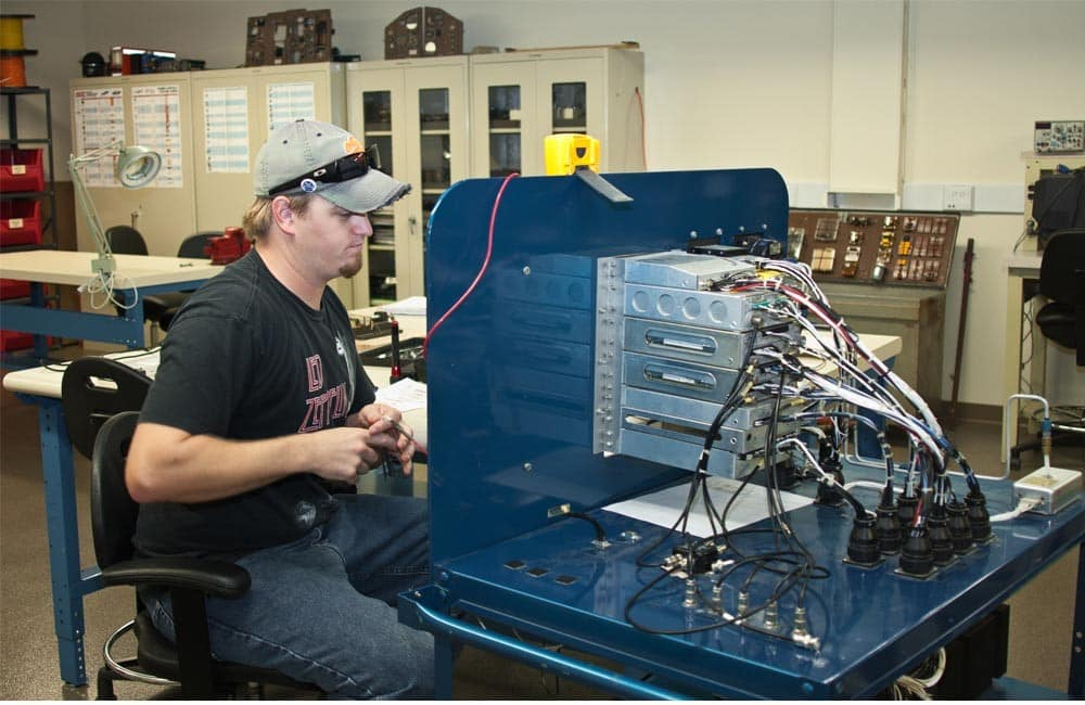 A student works on electronics in the Electrical Lab