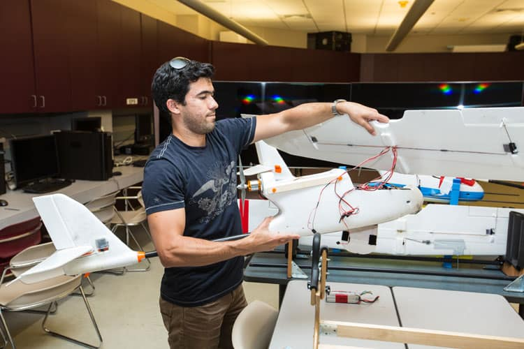 students in the Flight Dynamics and Control Research Laboratory