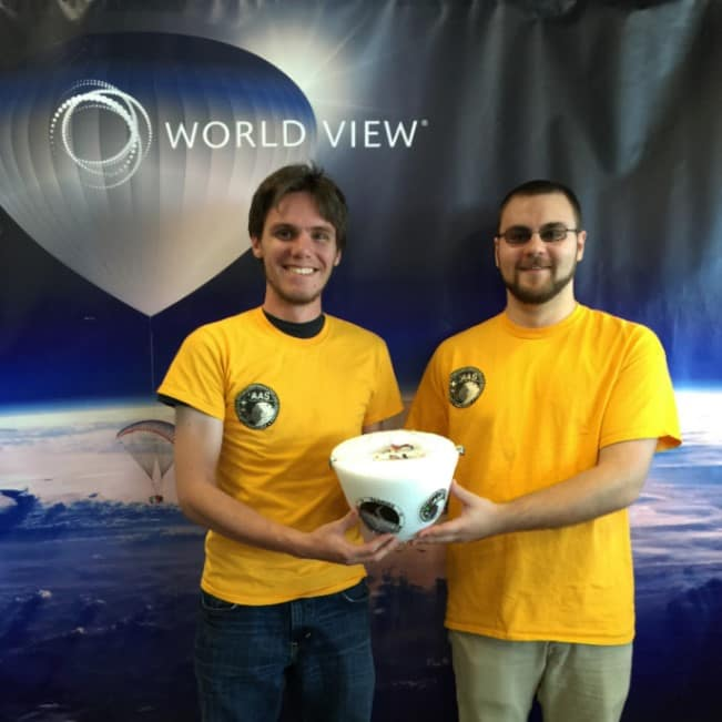 two students with a payload