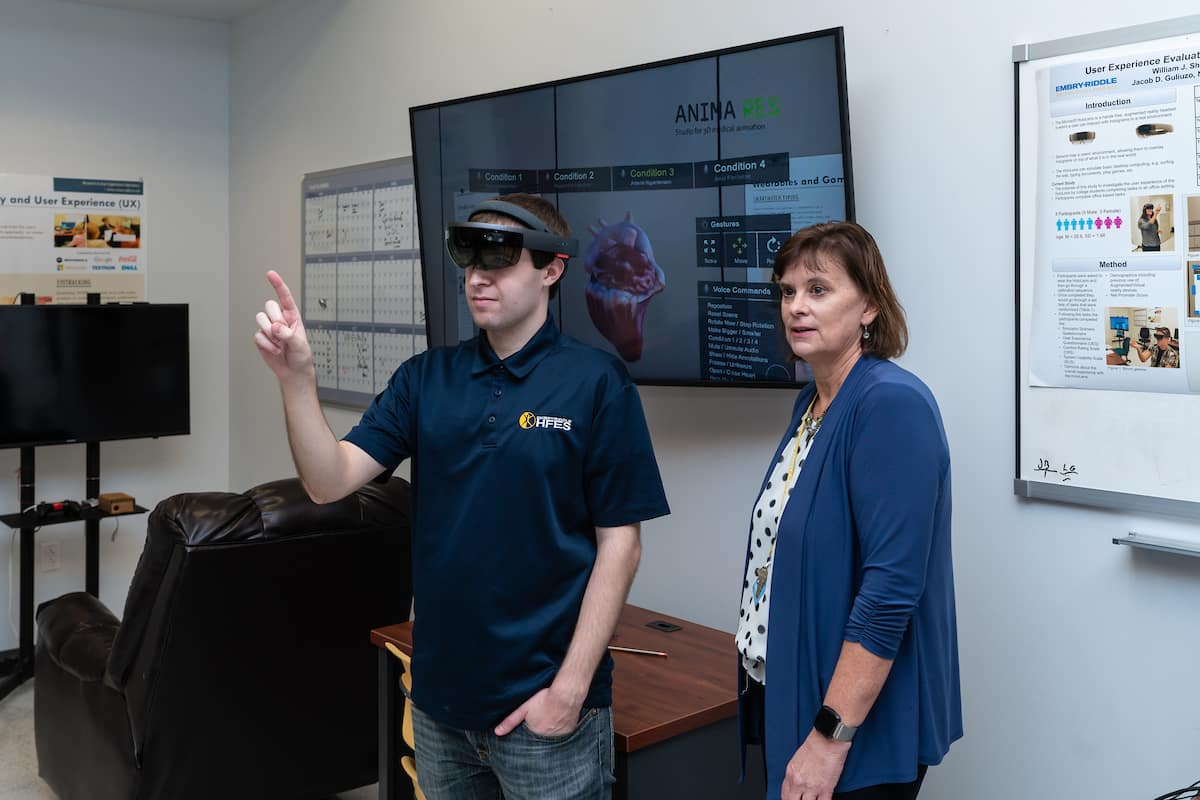 Ph.D. student William Shelstadt demonstrates a Microsoft HoloLens augmented reality headset using an application of a heart model and control gestures in the Human Factors User Experience Lab.