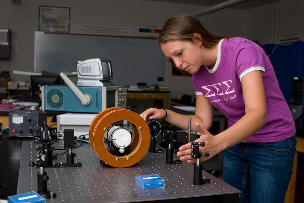 A student works on an experiment in the Space Physics Research Lab