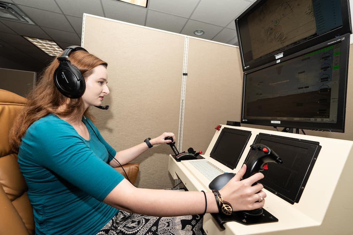 Female student working on a UAS simulator.