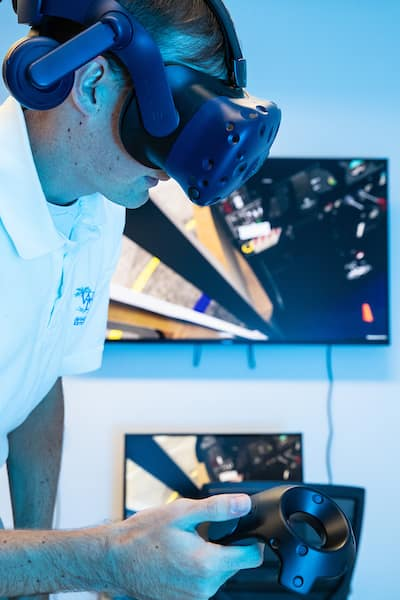 Student tests virtual reality headset in virtual reality lab