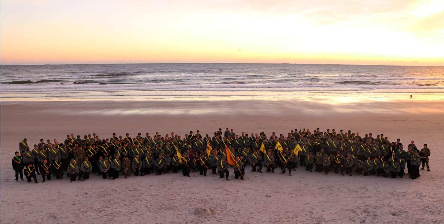 army ROTC gathered on a beach