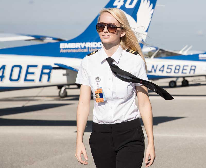 Embry-Riddle graduate Jessica Koeppen stands in front of an Embry-Riddle plane.