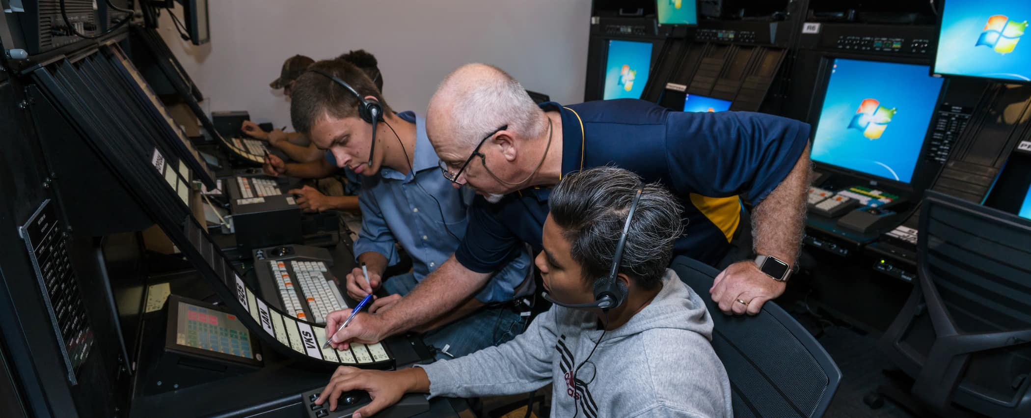 a professor and students in the air traffic lab