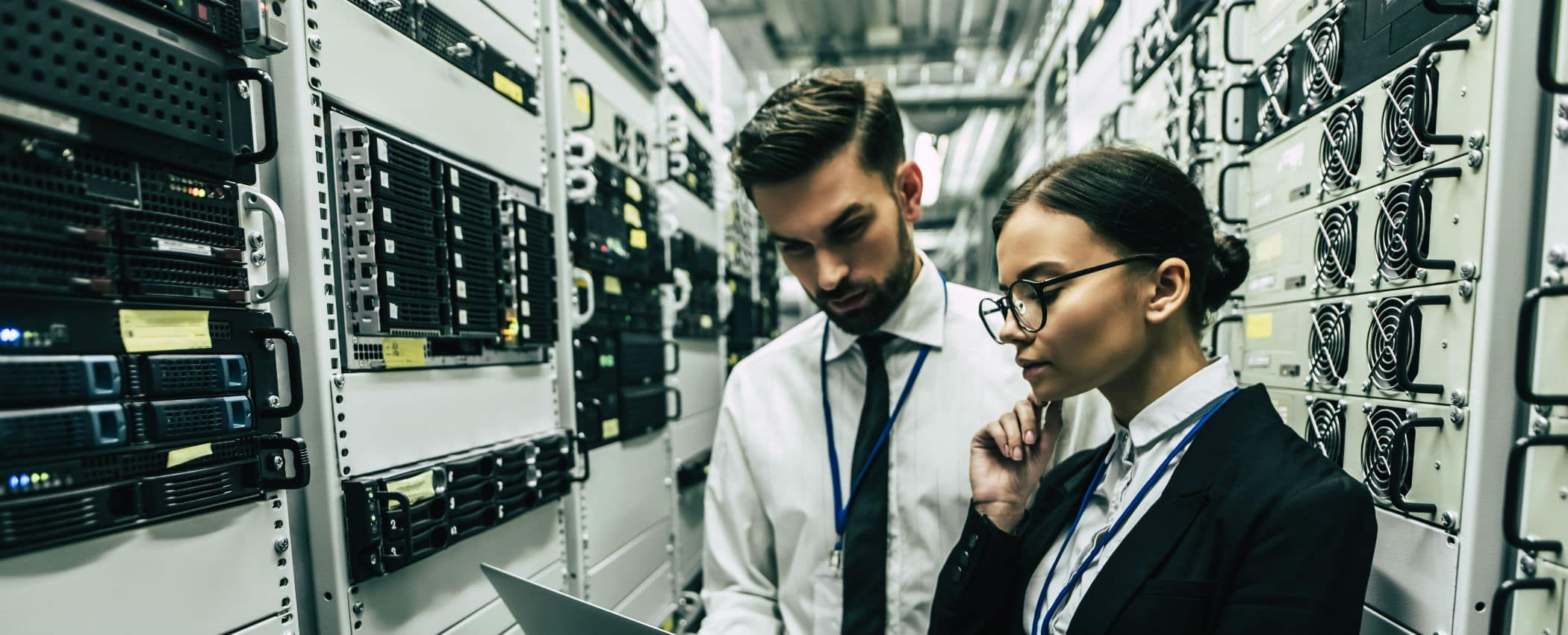 man and woman are working in data center
