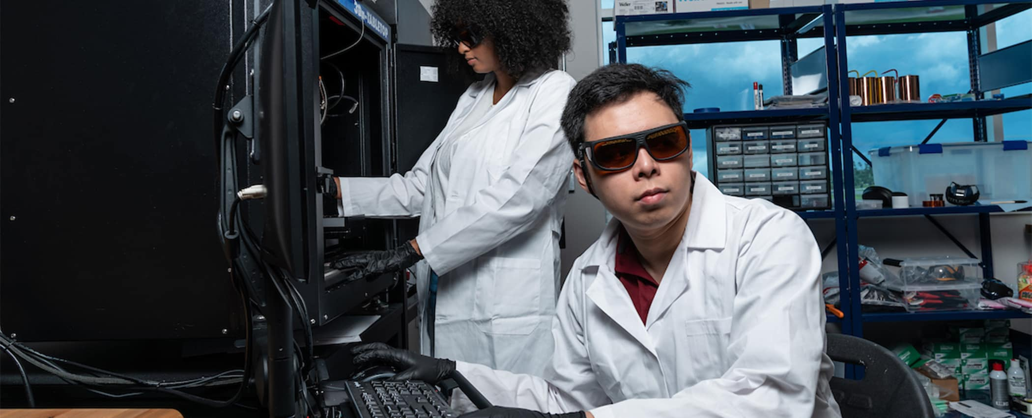 Man and woman research a computer network.