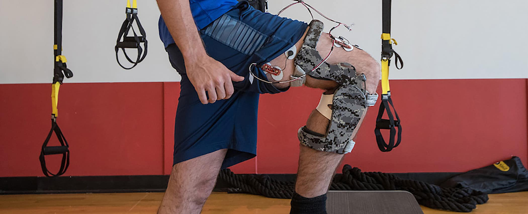 Man wearing a mechanical knee brace.
