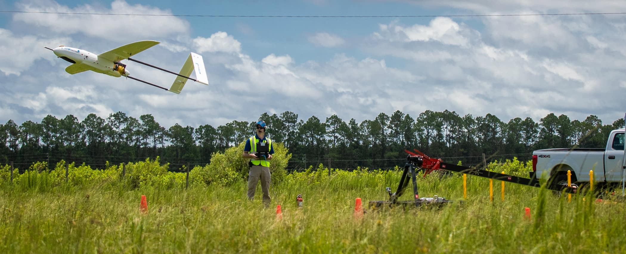 Michael Zebehazy,  UAS Maintenance and Inventory Manager and Crew Chief, left and Austin Noble, student and lab assistant launch the Penguin C UAV platform